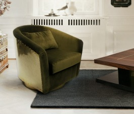 A green single velvet chair and a rectangular coffee table are key pieces for a reading corner decor.