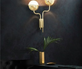 There is nothing quite like the feeling of walking into a room filled with character. Spreading an exotic golden light over this moody yet glamorous ambience, NIKU Wall Light helps to reveal a little