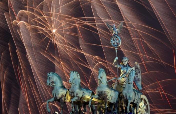 """Celebrating New Year 2014-Berlin_ Germany- Fireworks illuminate the night sky over the Brandenburger Tor"" Celebrating the new year 2014 Celebrating the new year 2014 Celebrating New Year 2014 Berlin  Germany Fireworks illuminate the night sky over the Brandenburger Tor e1388667169637"