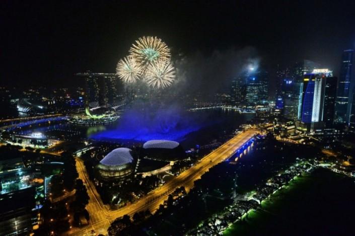 """Celebrating New Year 2014-Fireworks burst over the Singapore skyline during New Year celebrations"" Celebrating the new year 2014 Celebrating the new year 2014 Celebrating New Year 2014 Fireworks burst over the Singapore skyline during New Year celebrations e1388666233549"