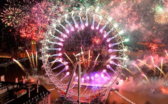 """Celebrating New Year 2014-Fireworks light the sky above the London"" Celebrating the new year 2014 Celebrating the new year 2014 Celebrating New Year 2014 Fireworks light the sky above the London e1388667365323"
