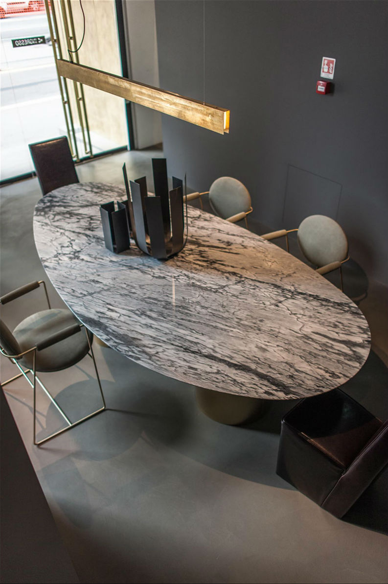 15 trendy rooms with marble d cor that will bring agra to you for Modern marble dining table
