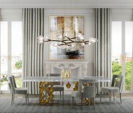Grey is a timeless neutral that never fails to add a sophisticated touch to any room. The softness of the velvet of NAJ Dining Chairs contrasts with the brushed brass base of KOI Dining Table. HORUS S