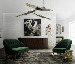 A modern home décor with a green velvet sofa and a mid century chair, a wood sideboard, contemporary ceiling lights, a modern floor lamp and a grey wool rug.