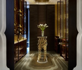 A luxurious hotel lobby decorated with one of the best contract furniture pieces - a gold display composed with several squares that result in an elegant and edgy shape.