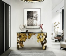 This KOI brass console table fits in any modern home decor. The KOI scales from the sides of the modern console table shine and reflect the sun on its brass surface.