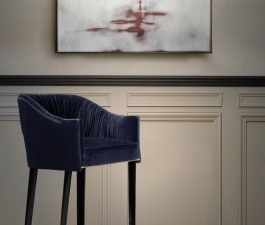 Give your home art the gallery look they deserve with luxury accent lighting and complement it with a modern design upholstery piece like Stola bar chair.